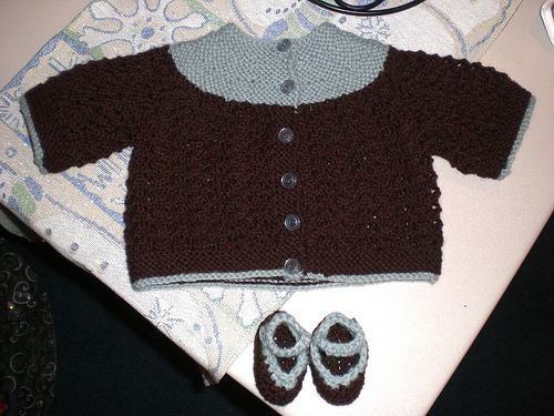 baby sweater and booties